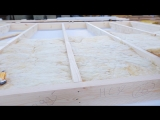 Сборка панелей каркасного дома в заводских условиях