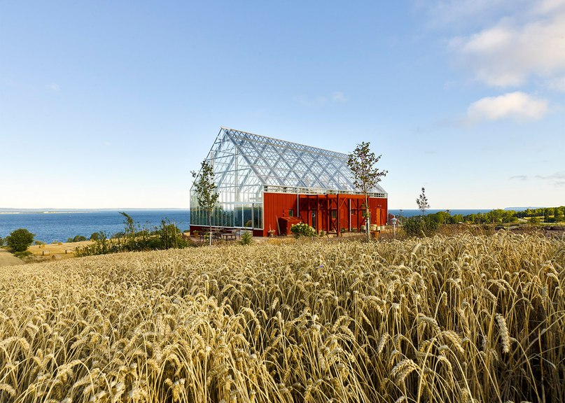 Tailor Made Arkitekter merges an archetypal barn with a glasshouse for lakeside spa in Sweden