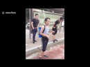 LiveLeak - Man keeps cool in street with bizarre portable shower