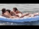 Нудистки в Одессе  плавают на матрасе голые