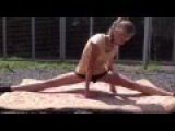 Gymnastics.Girls sit do the splits.