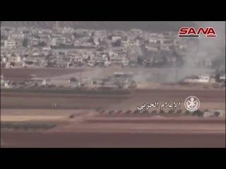 Сирия. САА обстреливает бармалеев в окрестностях деревни Маардес. Видео гос. ТВ Сирии.