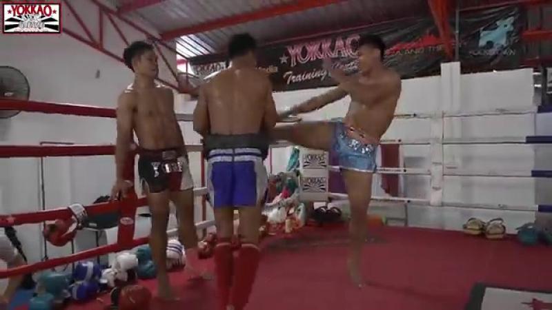Manachai demonstrating crazy speed kicks to Yodchai and Wuttichai