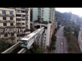 China Grab your ear plugs! This train literally runs straight through a block of flats