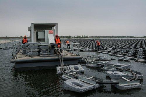 MbZCq6ppzlc В Китае ведется строительство самой большой в мире плавающей солнечной электростанции