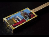 Cigar box guitar with bass pickup dedicated to Charley Patton