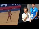 Zaripova watching Mamun's clubs routine 2015