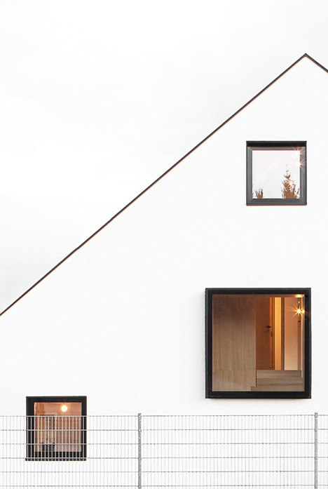 House B by Format Elf contains two floors within its large asymmetric roof