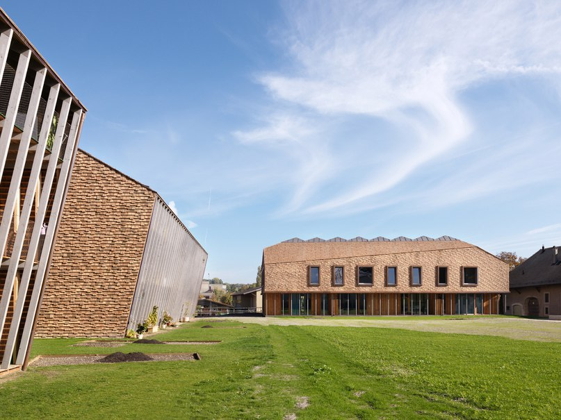 Two Residential Buildings, a Boarding School and an Activity Centre / bunq architectes