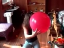 Great boom Alena blows to pop a red balloon
