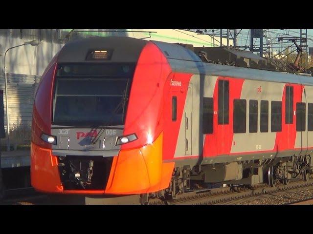 Электропоезда ЭС2Г-006 ЭС2Г-005 Ласточка проследует платформу НАТИ