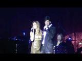 Sakis Rouvas and Joanna Pacitti singing at