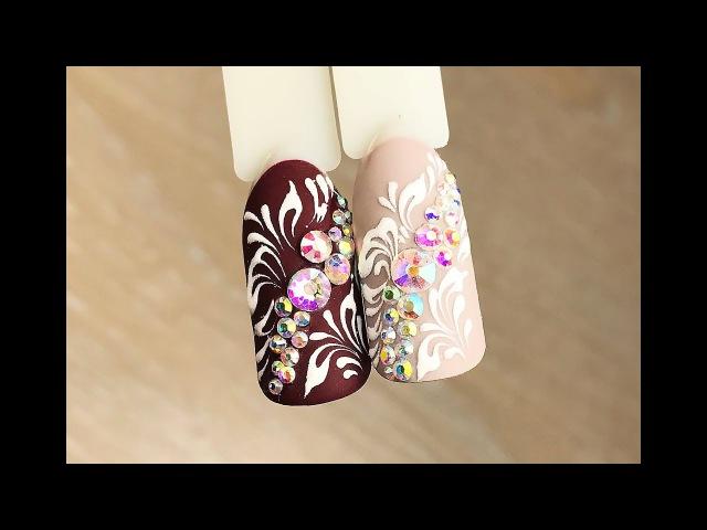 Дизайн ногтей Объемные вензеля со стразами. Гель-лаки Komilfo