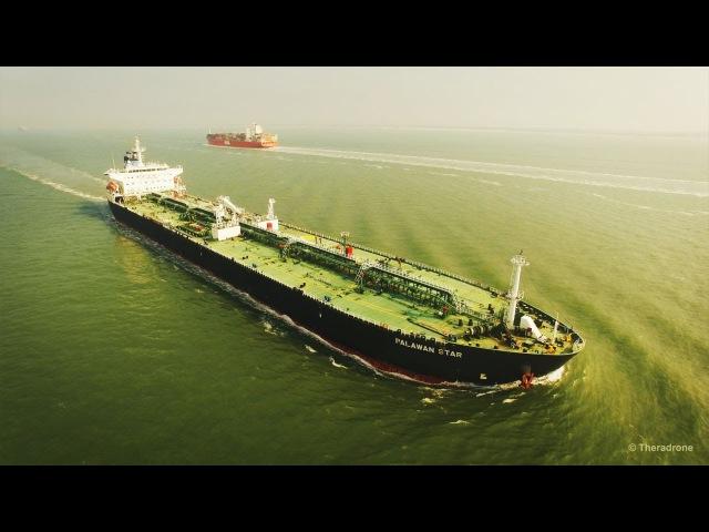 Tanker Palawan Star Container ship OOCL Belgium Aerial View at Sea 4K