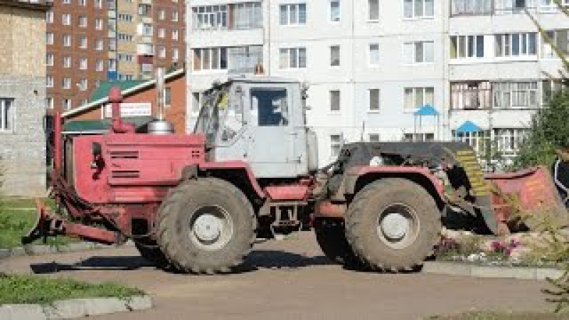 Трактор Т-150К - погрузка камней в ЗИЛ