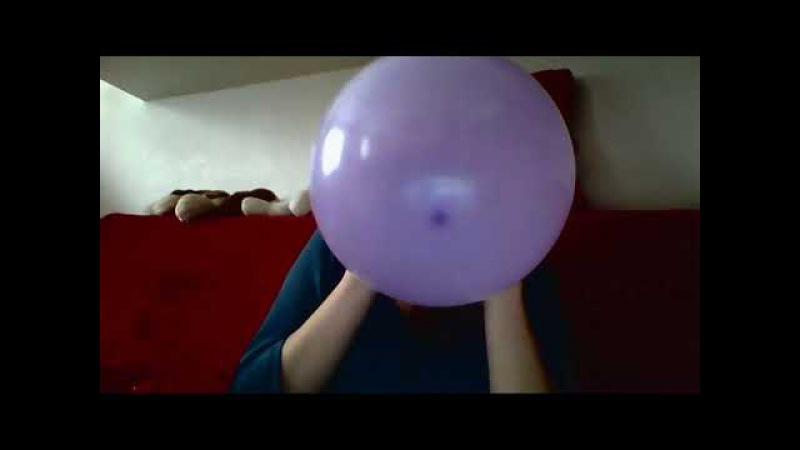 Girl blows to pop purple balloon straight away