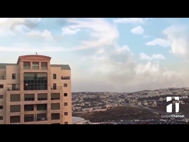 A weird cloud formation and strange trumpet sounds are heard over Jerusalem