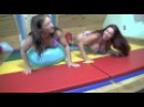 Two girls do a balloon popping challenge