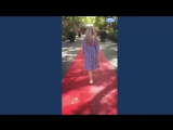 Beautiful amputee girl crutching on red carpet
