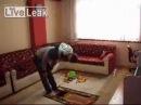 Сын смешно пытается помешать молитве отца
