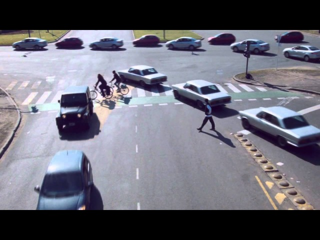 Rush hour intersection traffic condensed into one minute