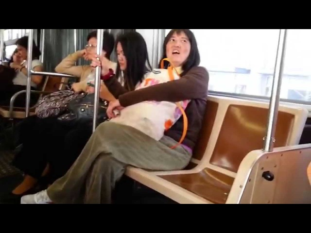 Schizophrenic Asian Woman Fights with Aggressive Homeless Man on S F Muni