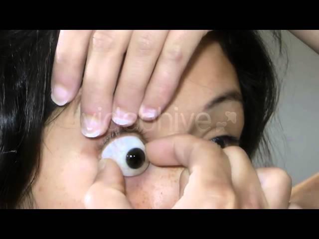 Taking Off Glass Eye Prosthesis