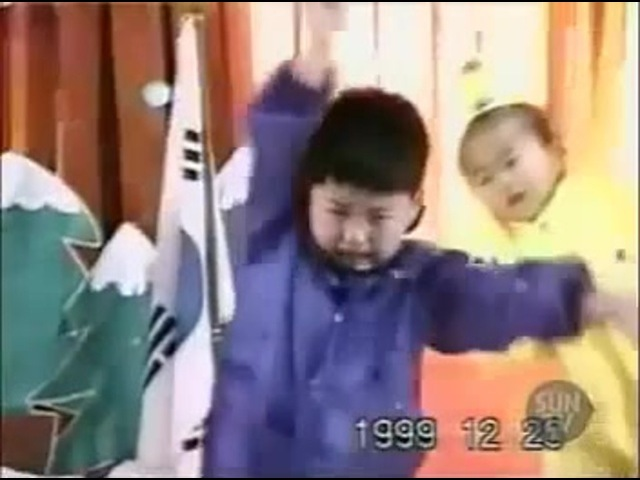 Asian boy dancing and crying