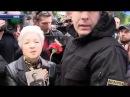 В Киеве националисты и полиция заставляют пожилую женщину снять георгиевскую ленту. Актуально