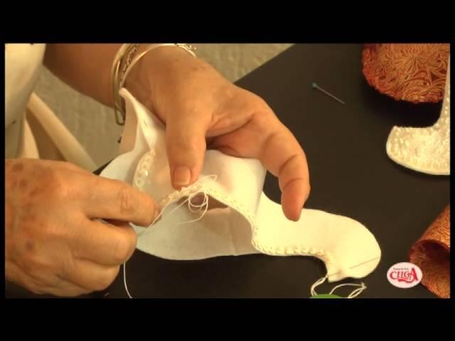Cibélia Alves ensina a montar um papai noel em feltro.