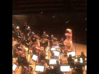 Jurassic Park theme conducted by a T-Rex