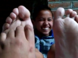 Young Latino boy having feet tickled.
