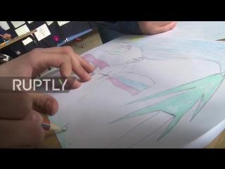 Ученики одной из школ в освобожденном от боевиков Алеппо разучили песню