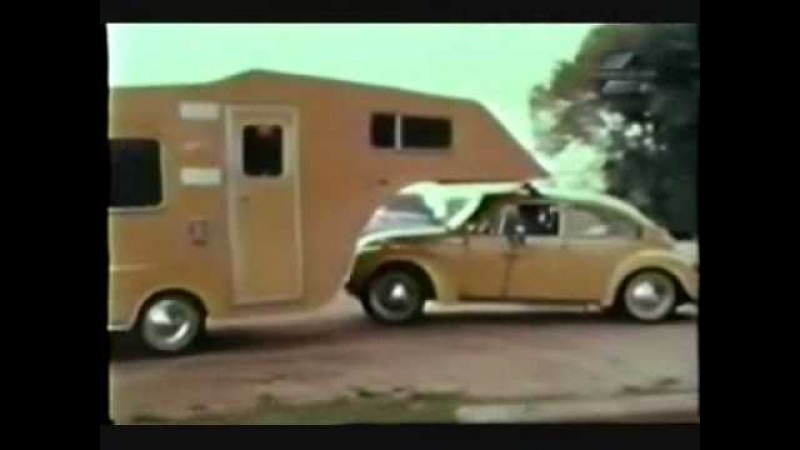 VW beetle towing a camper