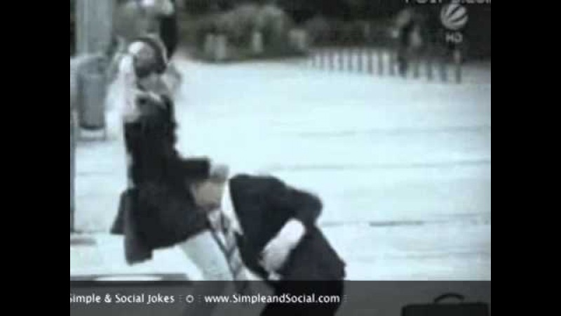Woman Dancing on Street teasing a man on a suit