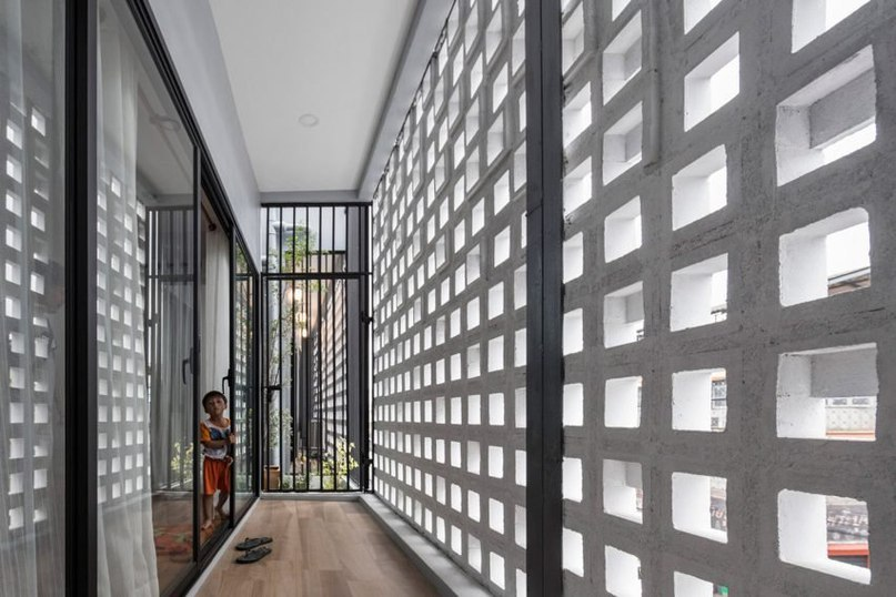 EKAR Architects designs concrete-block Thailand house for vet and pharmacist siblings