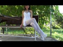 A Beauty in White Dress, Heels and Opaque Pantyhose HD Video