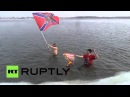 Russia See Siberian ice-swimmers BURN US flag for Donbass in FREEZING waters