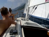 Young Russian pair enjoy the upwind sailing in Boka Bay Montenegro ......