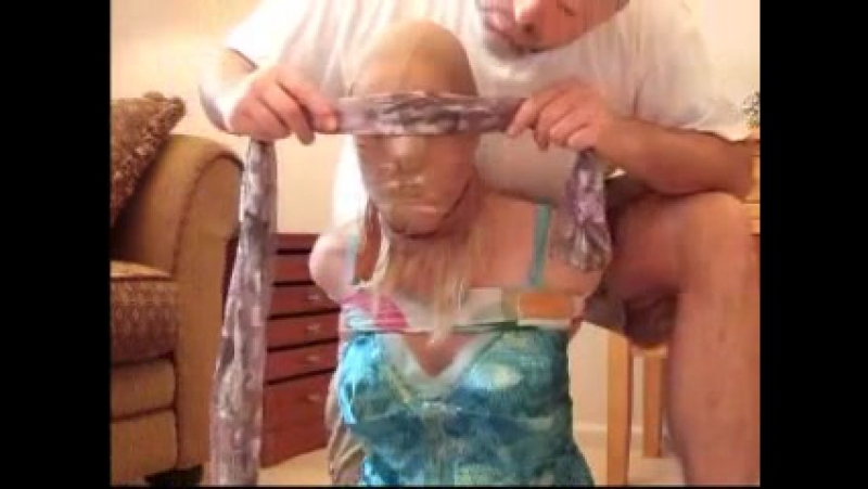 Scarf tied with 2 pair of panties in mouth...