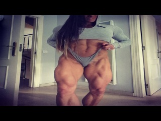 Truly huge, massive and shredded Female Bodybuilder flexes her giant muscles