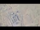Съёмка точного сброса бочковой бомбы с вертолёта на здание университета Аль-Джазира у посёлка Багилия вероятно непосредственн