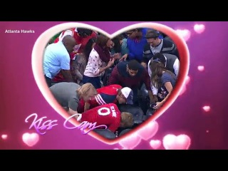 The awkward moment a man drops the engagement ring as he gets down on one knee during NBA kiss cam