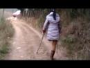 Chinese LAK amputee girl crutching on village path