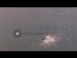 Strafing Japanese Sampan boat  and Japanese Navys flying boat Emily in Okinawa...HD Stock Footage