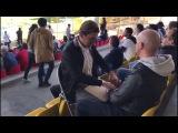 Deaf-blind man enjoys football (soccer) match with help. Слепо-глухой мужчина наслаждается футболом благодаря помощи друга.