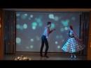 Буги-вуги. Танцы. Девушка в платье в горошек и пацанчик