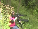 Pook pops off an Armalite AR 10 carbine