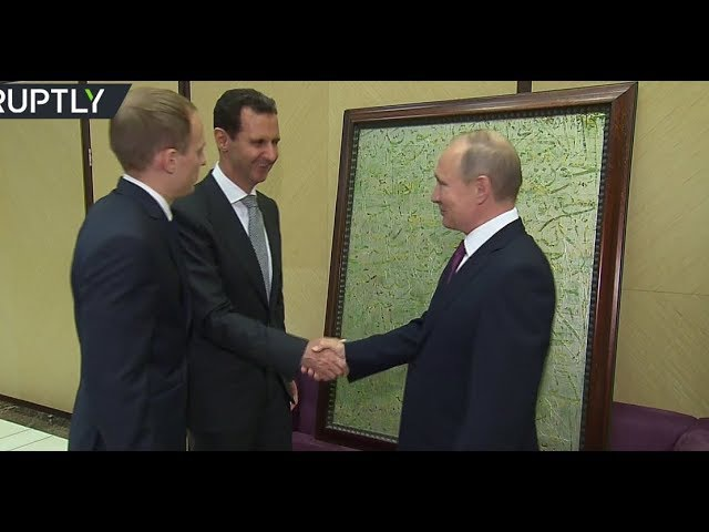 RAW: Putin receives painting from Assad during Syrian leader's visit to Sochi