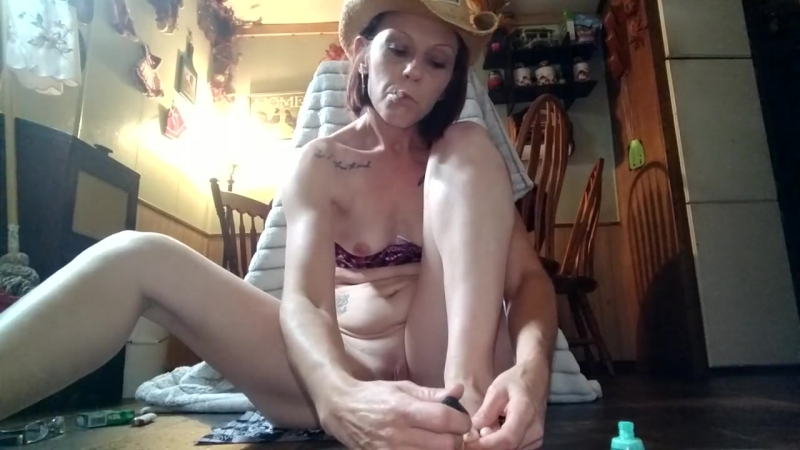 Sexy cowgirl paints her toes while masterbating and smoking a